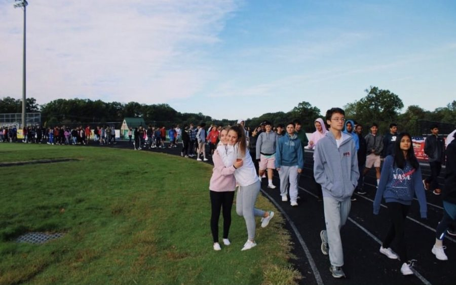 Juniors+Katie+Stanish+and+Brooke+Buckingham+embrace+each+other+at+the+WCHS+walk+for+Breast+Cancer+awareness+Oct.+17+during+school.+Many+students+wanted+to+participate+in+the+walk+but+felt+that+they+could+not%2C+for+they+feared+missing+out+on+educational+time.