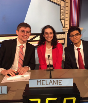 The three members of Churchill's It's Academic Team, Manu Sundar, Michael Kalin and Melanie Heller are in the photo. The photo depicts Manu, Michael and Melanie after they won the first round of It's Academic, competing against Watkins Mill High School and Sherwood High School.