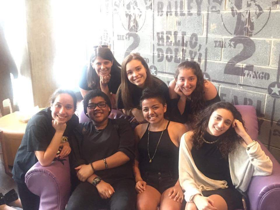 The WCHS slam poetry team poses after their 2017 competition with club sponsor, Christin Nixon, who also teaches English (top left).
