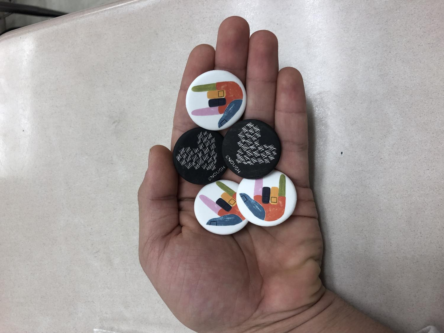 Moco for change gave out free pins to students who attended the march.