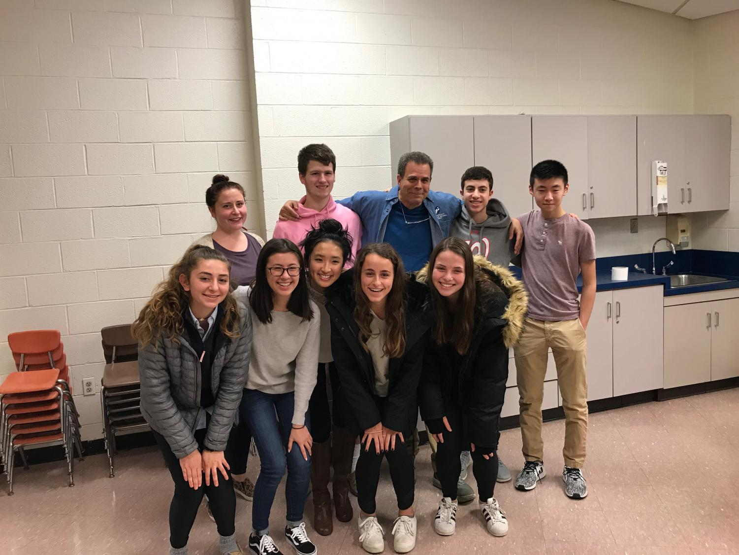 WCHS students devote time into volunteering at the Potomac Community Center. Left to Right: Beth Coffman, Assistant Director of Potomac Community Center, Luke Sumberg,  Sydney Rodman, Macafie Bobo, Abbey Zheng, Julia Greenberg, Jordyn Reicin, Peter Selikoqirz, Director of Potomac Community Center, Adam Horowitz, Andrew Chan.