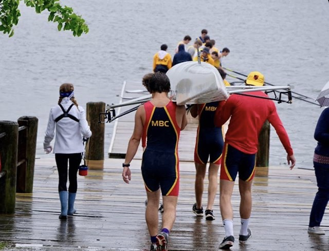 Members of the Montgomery Boat Club carry a shell to the water at the previous practice location, the Anacostia River. Practicing here was difficult due to the long travel times, which led to a short amount of time in the water and late arrivals, as well as the limited space available for them to prepare for races.