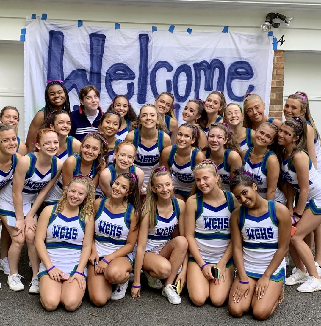 WCHS Varsity Cheer welcomes the newest additions to the team before the season opener football game.