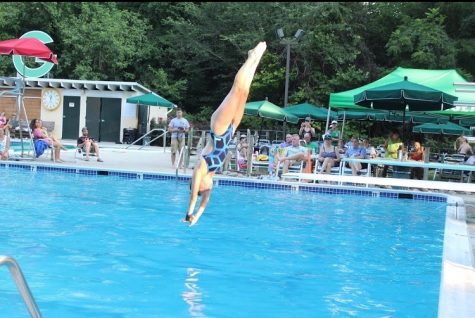 Sophomore Sydney Norris practices her dives at her practice during the summer. Norris dives year round and does not have breaks between seasons, allowing for more developed skills.