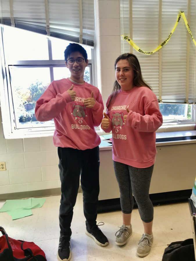 Juniors+Brian+Hung+and+Grace+Merola+rock+the+pink-out+sweatshirts+during+world+history+class.+The+pink-out+sweatshirts+were+worn+by+many+%0AWCHS+students.