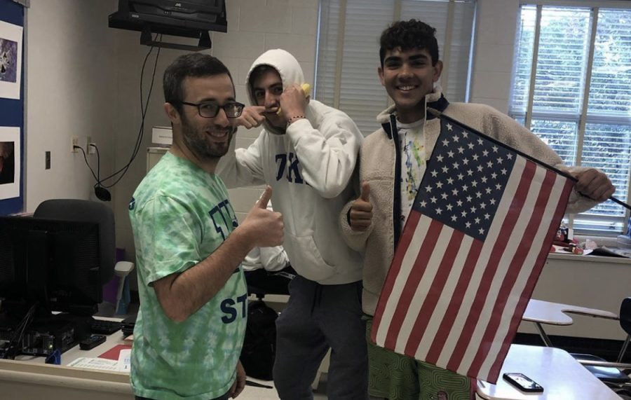 Mr. Rosenthal, David Miskin, and Jay Wood pose with an American flag in spirit of USA day.
