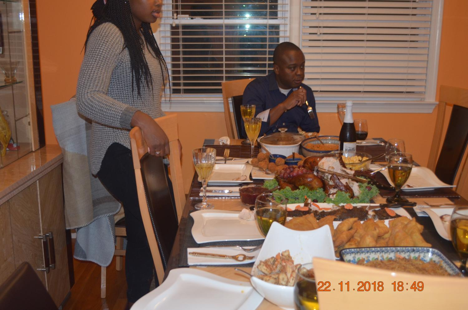 The dining table is set fora typical Thanksgiving dinner.