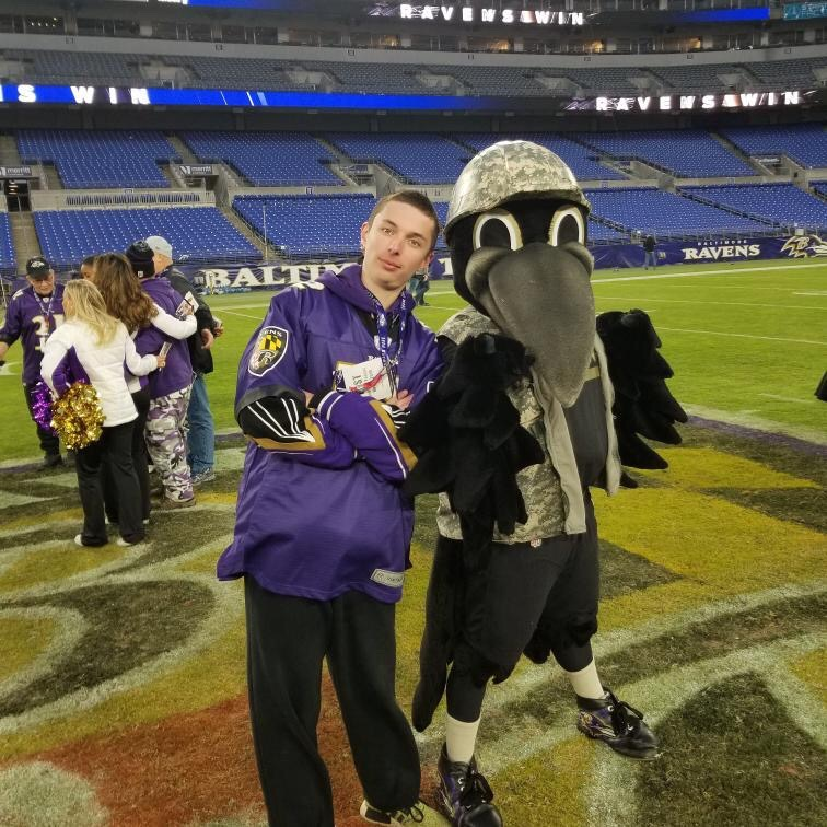 Robinson poses alongside Baltimore Ravens mascot, Poe, during his postgame experience at M&T Bank Stadium.