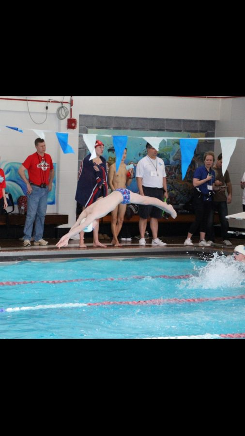 Junior+Cameron+Barclay+exhibiting+his+athletic+skill+with+a+graceful+swan+dive+to+start+the+race.