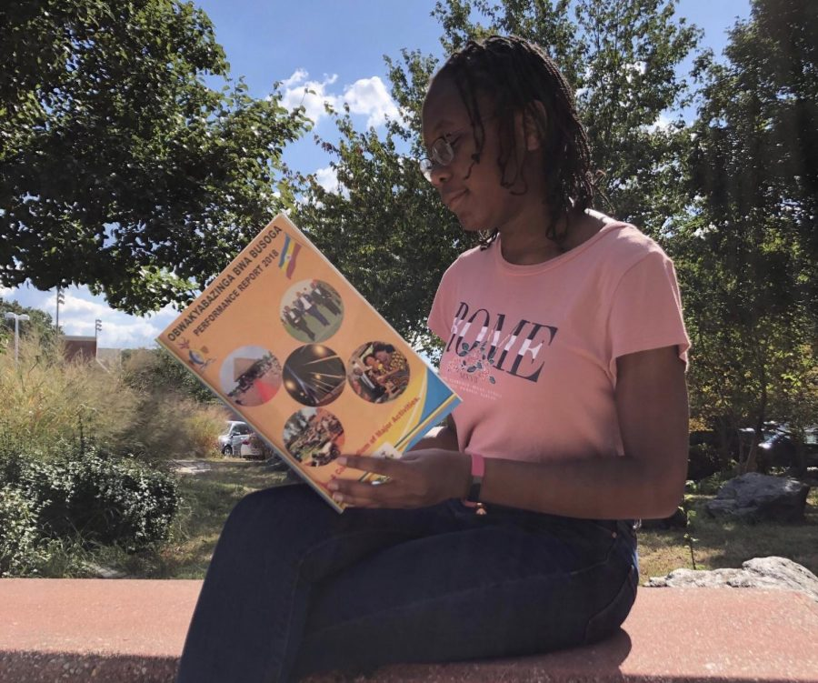 Queen Balina tells her story by posting this photo on the ISA Facebook page. She wants others to know how she feels about her culture, as shown by the book, and encourage others to share as well.
