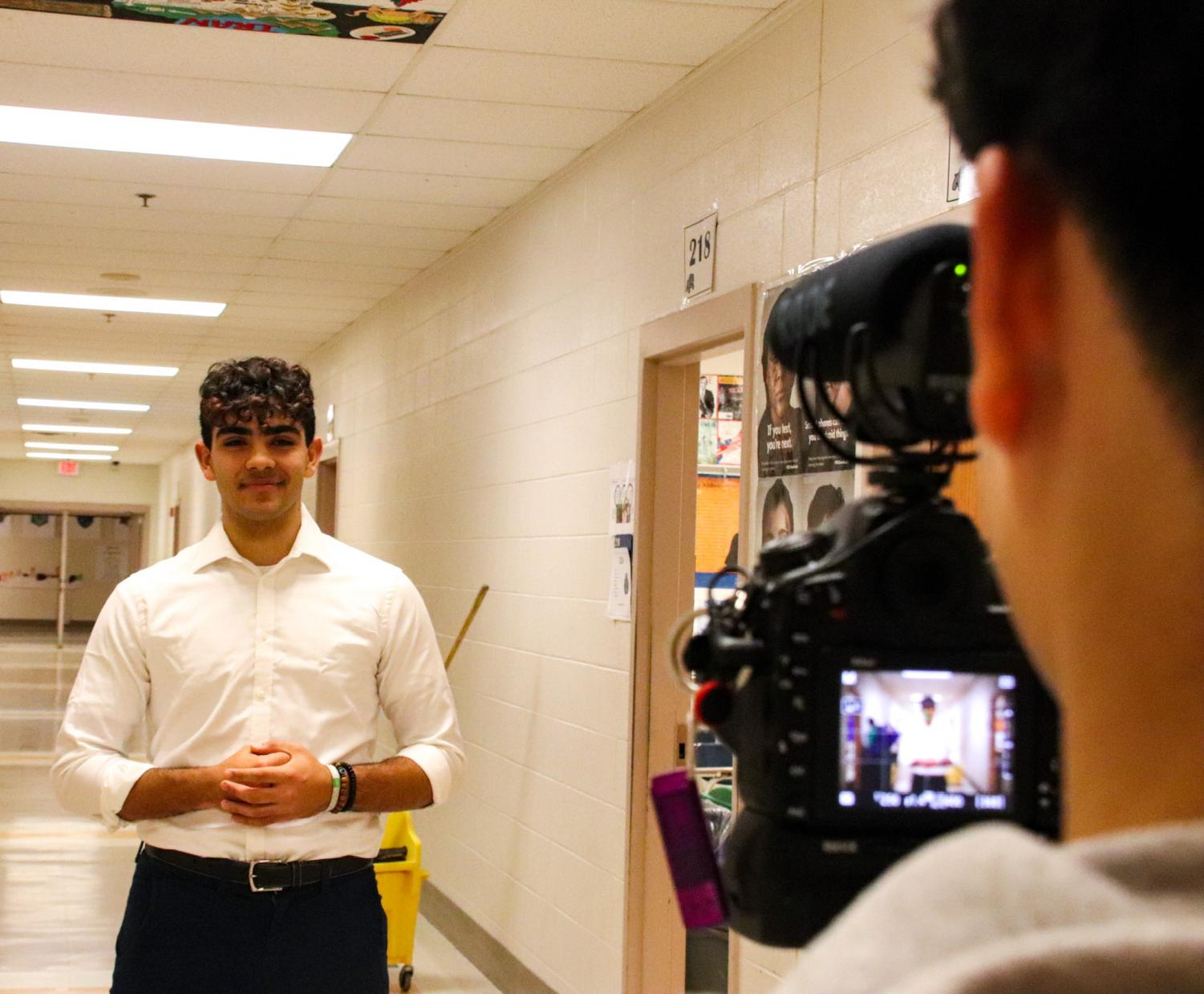 WCHS President Jay Wood preparing to speak for his SMOB announcement video in the halls of WCHS.