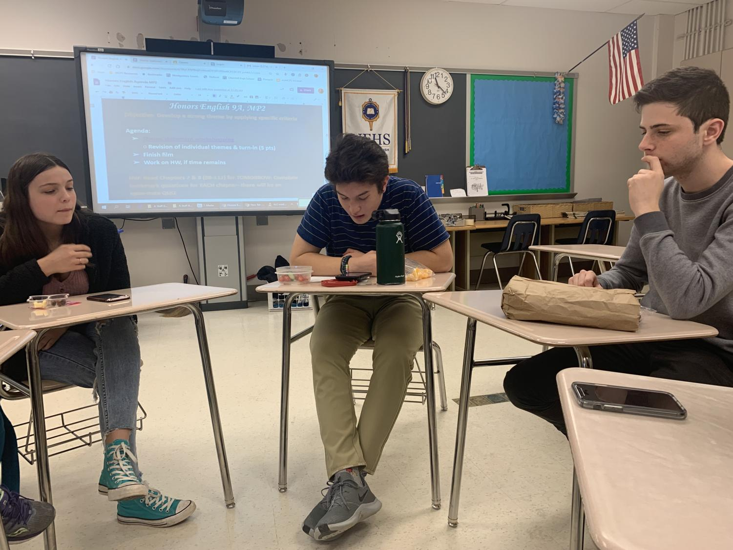 """Senior Mary Hinton (left) and Junior Trevor Gardemal (right) join EHS student board member Jonathan Silverman (middle) to discuss Ray Bradbury's short story """"There Will Come Soft Rains"""" on Nov. 21st. These book club meetings occur around once a month and members can request which books to read and discuss."""