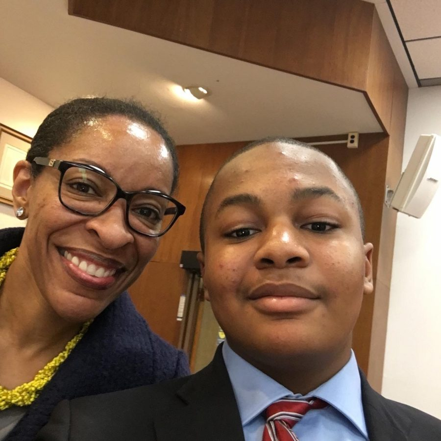 Cabin John Middle School President, Sekayi Fraser, poses with the Montgomery County Board President when he testified for the use of 2 ply toilet paper to the Board of Education.
