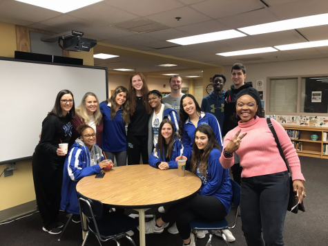 Members of WCHS varsity basketball team pose with their teachers in the media center during an appreciation coffee for staff.