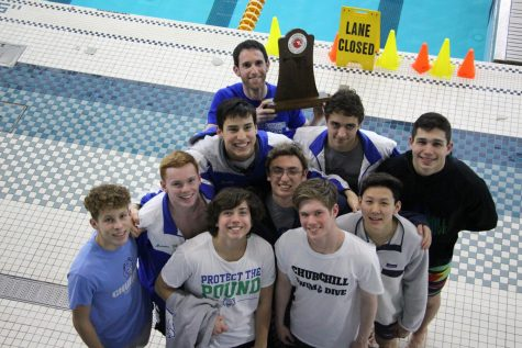 Casey Meretta and his teammates on the WCHS Swim and Dive team pose with their trophy. The won second place at the Maryland State Championships.