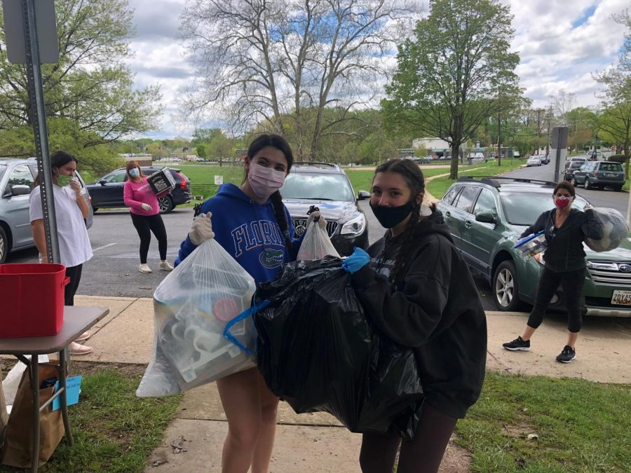 RMHS+sophomore+Christina+DeFiore+%28left%29+is+joined+by+other+RMHS+students%2C+helping+the+DMV+community+by+volunteering+with+the+Covid+Cadets.+The+Covid+Cadets+collect+donations+from+doorsteps+and+front+porches%2C+taking+them+to+So+What+Else%2C+an+organization+that+donates+toys%2C+games%2C+clothes+and+many+more+to+low-income+families+in+the+area.