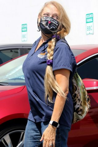 Dancing With The Stars celebrity competitor, Carole Baskin, arrives on set for a day of rehearsals wearing a mask. All celebrities are required to wear masks when they are not inside the studio alone.