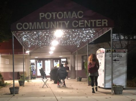 Junior Bridget Kelly (right) walks into the Potomac Community Center on Oct. 28 for her assignment as a poll worker. Kelly