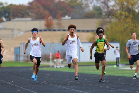 Andrew Xue (far left) races in the 100 meter event at the Urbana Track Series Meet, head-to-head with fellow WCHS runner Langston Major. Xue finished second overall in the event. With no MCPS indoor track season, Xue took it upon himself to run at club track meets for the Corentyne Coasters.