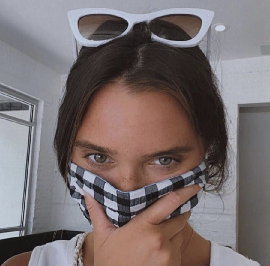 Social+media+influencer+Hannah+Meloche+wears+a+mask+made+by+student+run+Solidarity+Masks.+Wearing+masks+are+necessary+to+stop+the+spread+of+COVID-19.+