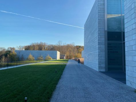 WCHS senior Holly Shimabukuro stands outside of the entrance to the Pavilions building complex at the Glenstone art museum. The buildings hold most of Glenstone's indoor artworks and installations, and has become the de-facto centerpiece of the mixed indoor-outdoor museum.