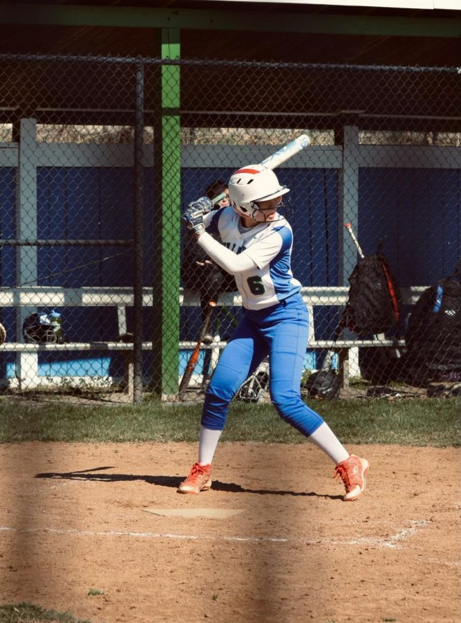 Daniella Lew, who wears number six on her jersey, gets in her batting stance at a home game. Pre-COVID, Lew played many in-person games, both at WCHS and at the opposing schools.