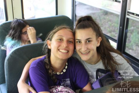 Tova Niles sits on the bus with a friend on the way to sleep away camp. She had attended for five summers in a row before it being cancelled last year.
