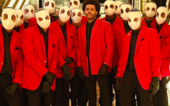 Inside one of his many Super Bowl Halftime Show backdrops, The Weeknd stands side by side a few of his extras for the performance. The extras were dressed to look like clones of The Weeknd for the February 7th performance.
